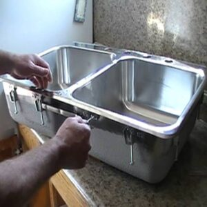 Installing a Steel Queen stainless steel kitchen sink.