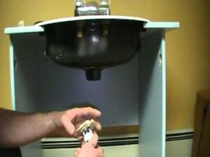 Old plumber shows how to install a bathroom sink (basin) drain.P.O.plug... plug and chain