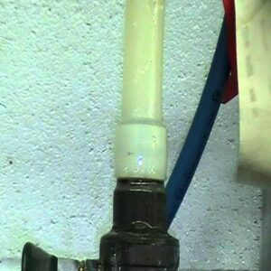 Pinholes and cracks (leaks) in pex (plastic) pipe from light fixtures.