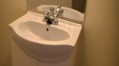 Space saving vanity with porcelain basin...Ideal for tight quarters!!!