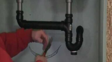 The Old plumber shows how to Install drain pipes on a kitchen sink..